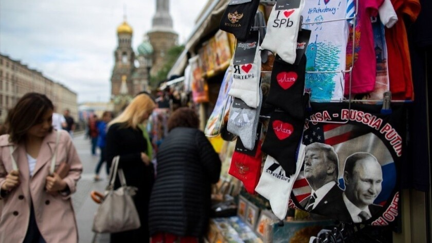 Shirts with pictures of President Trump and Russian President Vladimir Putin are displayed at an open market in St. Petersburg, Russia,