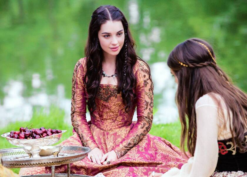 """Adelaide Kane, left, stars as Mary, Queen of Scots, left, and Caitlin Stasey as Kenna in the CW series """"Reign."""""""