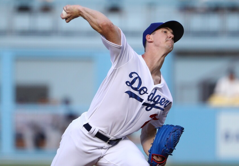 Dodgers starter Walker Buehler delivers during the first inning against the Colorado Rockies on Monday.