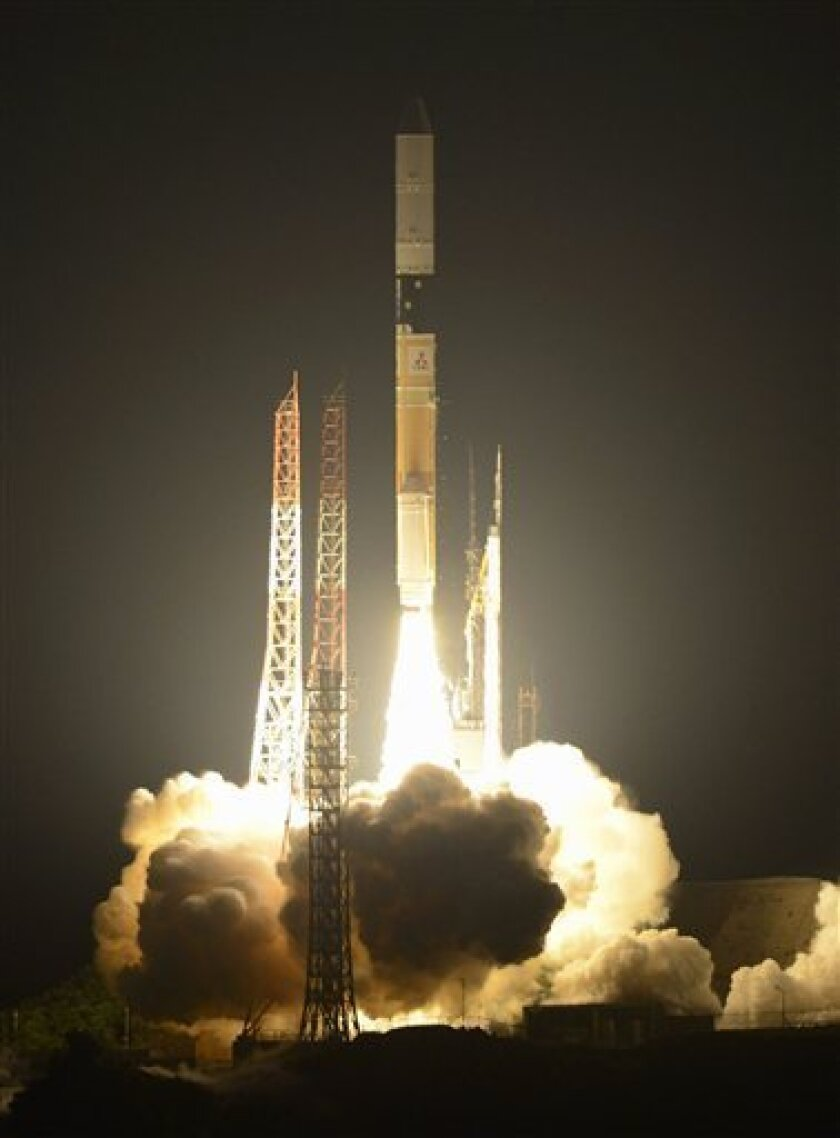 A H-2A rocket lifts off from the Japan Aerospace Exploration Agency's Tanegashima Space Center on Tanegashima Island in Kagoshima Prefecture, southwestern Japan, early Friday, May 18, 2012. JAXA and Mitsubishi Heavy Industries Ltd. successfully launched a South Korean satellite into space aboard th
