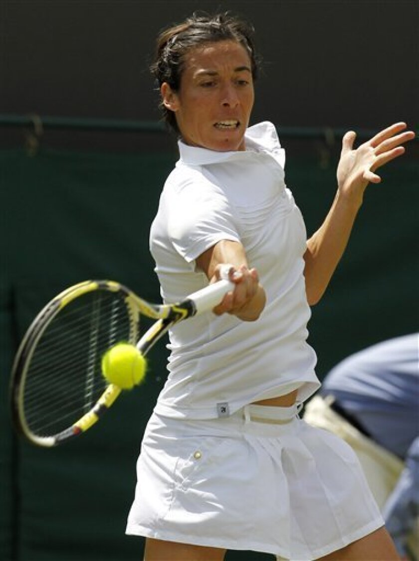 Italy's Francesca Schiavone returns a shot to Barbora Zahlavova Strycova of the Czech Republic during their match at the All England Lawn Tennis Championships at Wimbledon, Thursday, June 23, 2011. (AP Photo/Anja Niedringhaus)