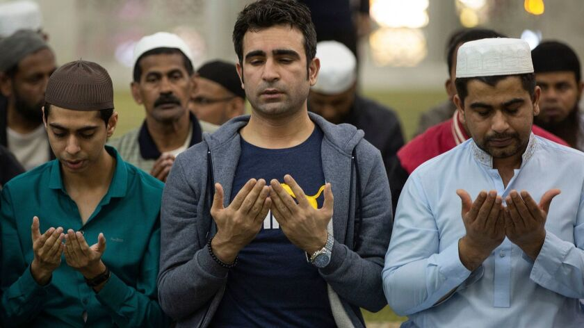 People pray at the Kowloon Mosque Tsim Sha Tsui in Hong Kong on Saturday for victims of the mosque attacks in Christchurch, New Zealand.