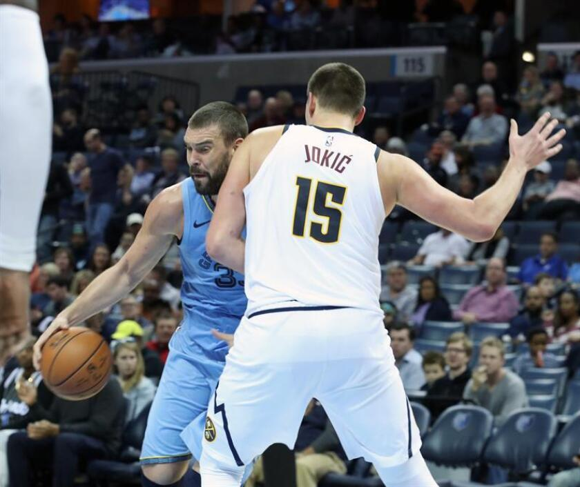 Memphis Grizzlies center Marc Gasol (L) looks to maneuver past Denver Nuggets counterpart Nikola Jokic (R) in the second half of an NBA game at the FedExForum in Memphis, Tennessee, United States, on Nov. 7, 2018. EPA-EFE/Karen Pulfer