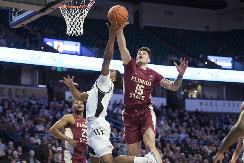 Florida State's Dominik Olejniczak (15) blocks Wake Forest's Brandon Childress (0) shot in the first half of an NCAA college basketball game Wednesday, Jan. 8, 2020 in Winston-Salem, N.C. (AP Photo/Lynn Hey)
