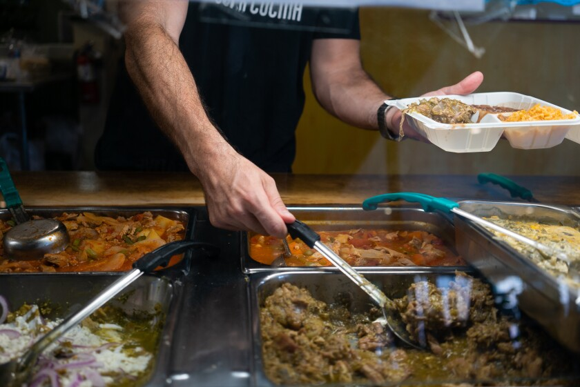 Super Cocina distributed meals on Thursday to City Heights community members impacted by job loss