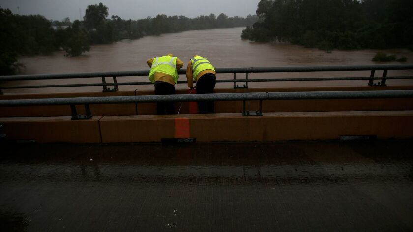 Work crews take measurements of the Brazos River as flooding continues throughout the greater Housto