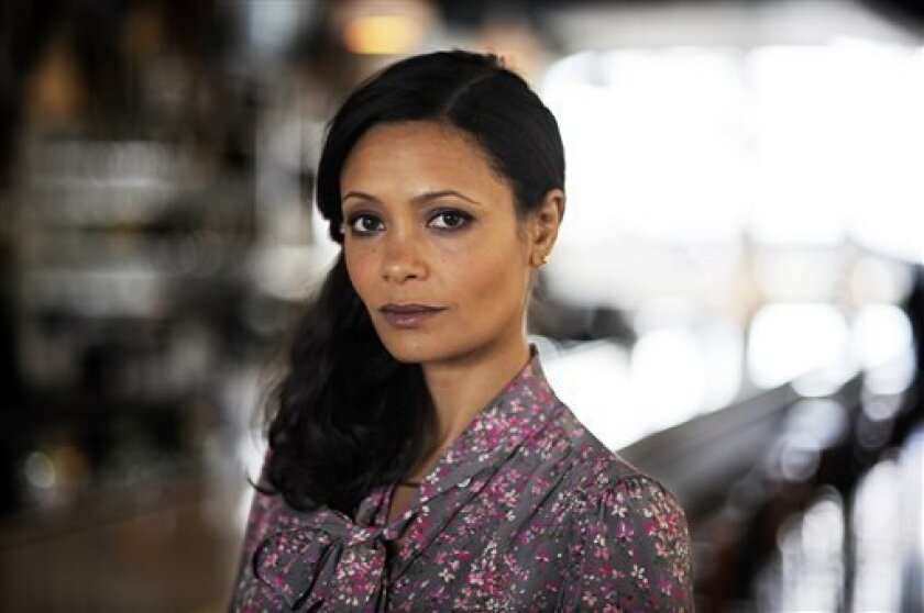 "In this Thursday, March 28, 2013 photo, actress Thandie Newton poses for a photograph, in Atlanta. Newton stars as a conflicted undercover cop in a new television crime series, ""Rouge,"" airing April 3, 2013. (AP Photo/Mike Stewart)"