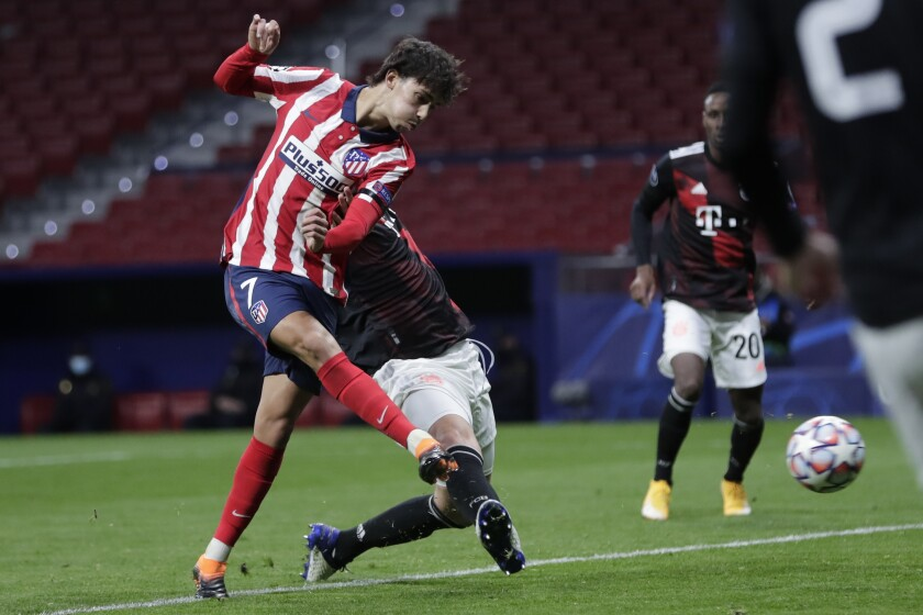 Atletico Madrid's Joao Felix kicks the ball to score his side's opening goal during the Champions League group A soccer match between Atletico Madrid and Bayern Munich at the Wanda Metropolitano stadium in Madrid, Spain, Tuesday, Dec. 1, 2020. (AP Photo/Bernat Armangue)