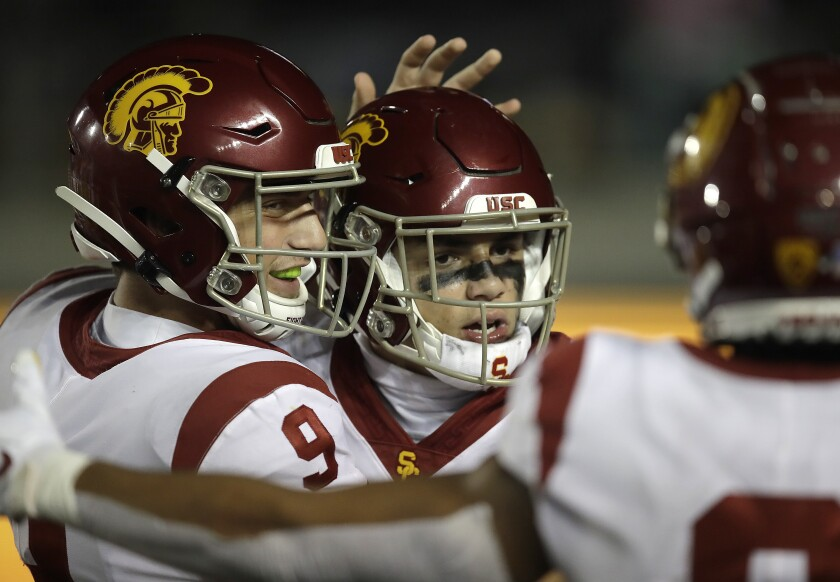 USC quarterback Kedon Slovis (9) celebrates with Drake London after London's touchdown against California in the second half in Berkeley.