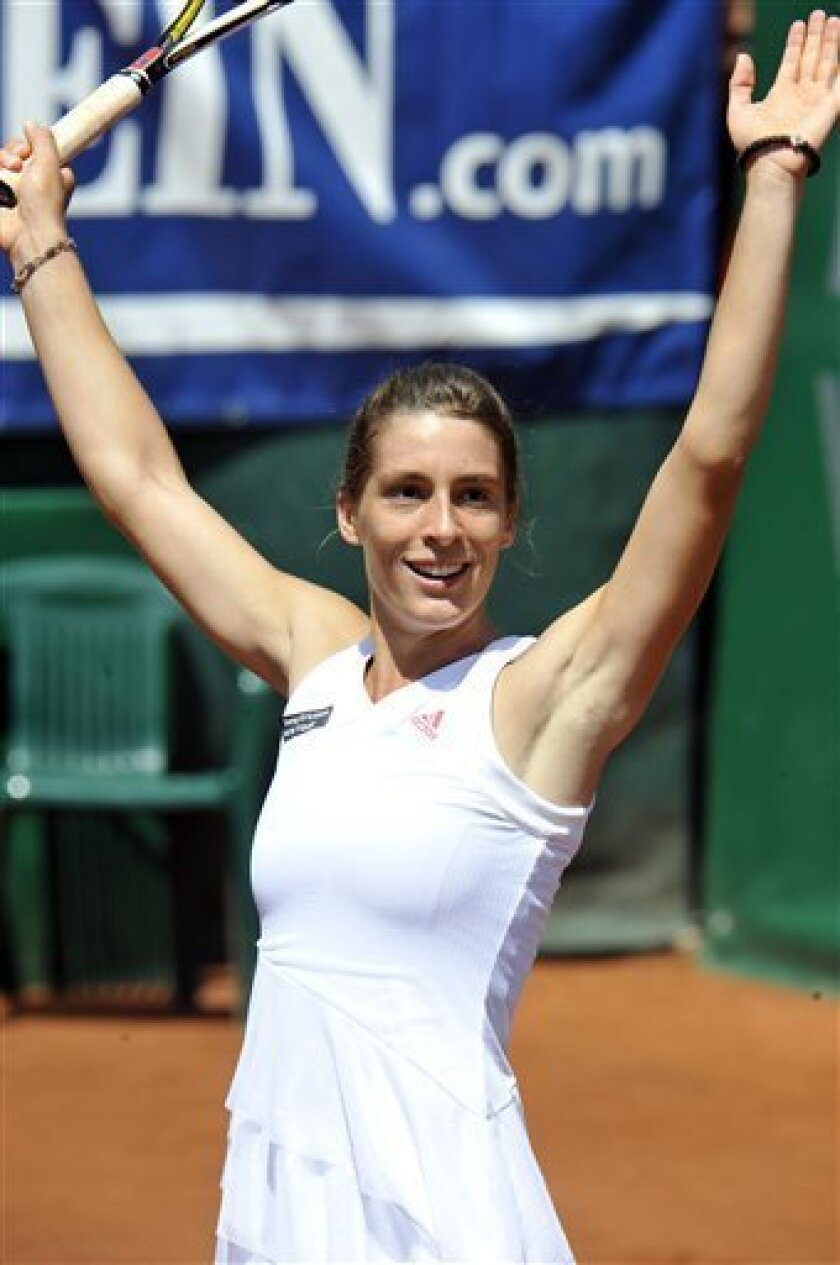 Germany's Andrea Petkovic  reacts after her final match against Romania's Ioana Raluca Olaru at the Gastein Ladies 09 tennis tournament in Bad Gastein, Austria, on Sunday July 26, 2009. Petkovic  won 6-2 and 6-3. (AP Photo/Kerstin Joensson)