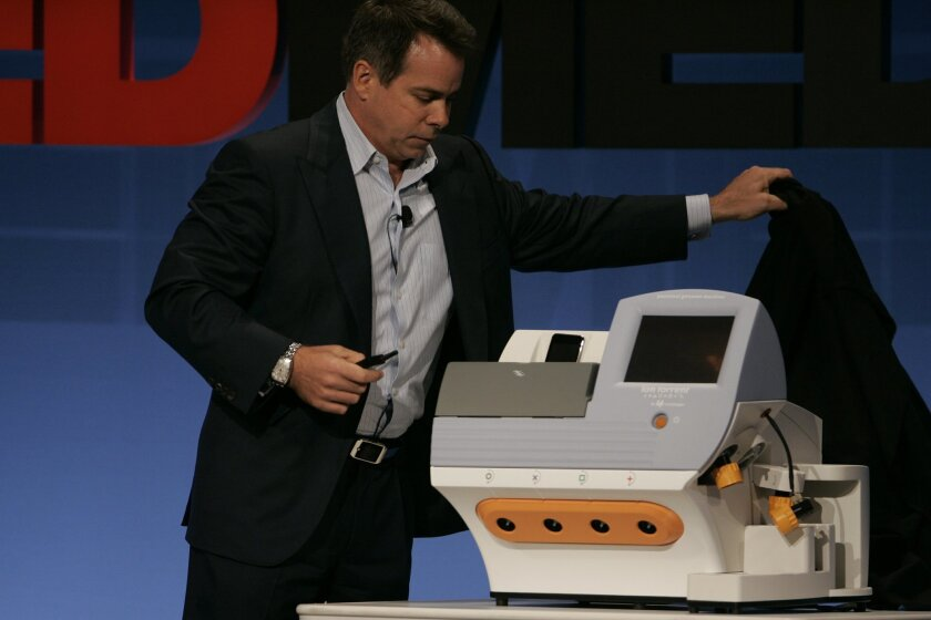 Greg Lucier, chairman and CEO of Carlsbad-based Life Technologies, showed off the Personal Genome Machine, which uses new technology to deliver full genome sequences in less time and at a lower cost. An older generation sequencer made by Life Technologies was used to process Ozzy Osbourne's blood s