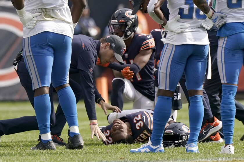 Chicago Bears running back David Montgomery grimaces in pain after being injured during the second half of an NFL football game against the Detroit Lions Sunday, Oct. 3, 2021, in Chicago. (AP Photo/Nam Y. Huh)