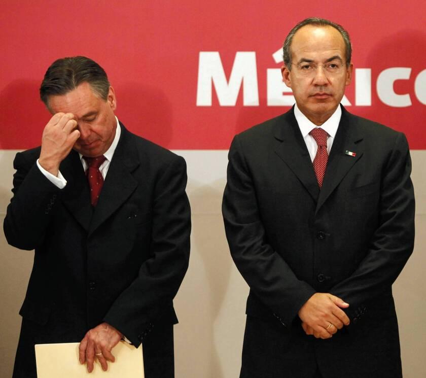 Mexico's former Atty. Gen. Eduardo Medina Mora, left, with then-President Felipe Calderon, in 2009.