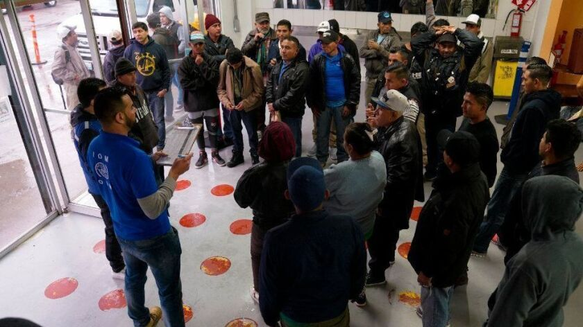 Late afternoon on Monday, an official from the International Organization for Migration gives transportation instructions to the group of 32-men and 3 women at the Desayunador Salesiano Padre Chava shelter in Tijuana that have volunteered to return to their home countries.