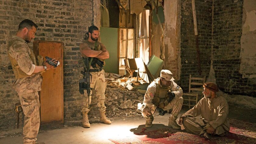 """Dave Annable, Colby Lopez, Wesley Snipes and Eyas Younis in the film """"Armed Response."""" Credit: Alfon"""