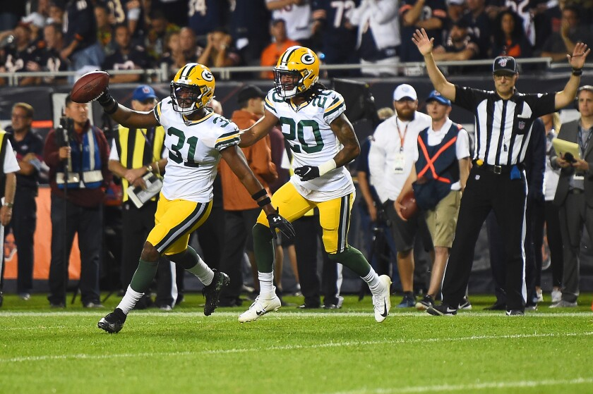 Green Bay Packers' Adrian Amos (31) celebrates an interception during the second half against the Chicago Bears on Thursday in Chicago.
