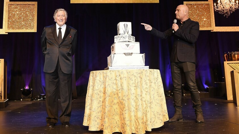 Tony Bennett (left) and Howie Mandel stand beside a giant cake during a gala dinner marking Caesars Palace's 50th birthday in August.