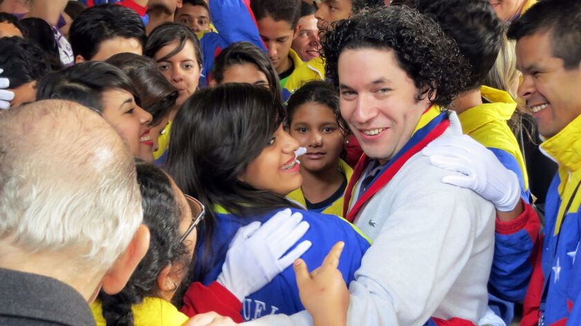 Gustavo Dudamel among students at a 2012 showcase performance of El Sistema students with special needs, in Caracas, Venezuela.
