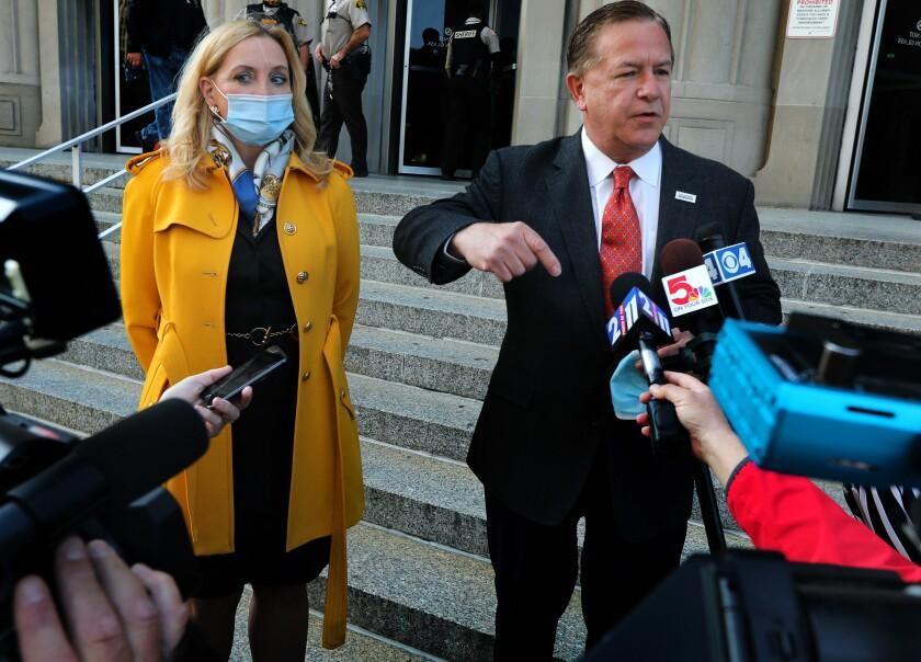 Mark McCloskey addresses the media alongside his wife, Patricia, on Tuesday.