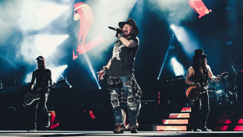 Welcome back to the jungle: Axl Rose finds his snake hips as