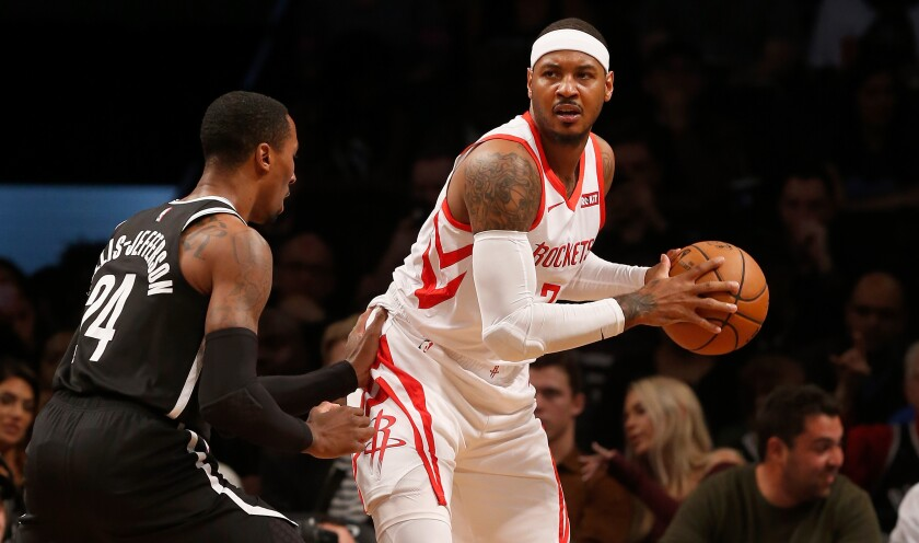 Houston Rockets small forward Carmelo Anthony controls the ball against the Brooklyn Nets.
