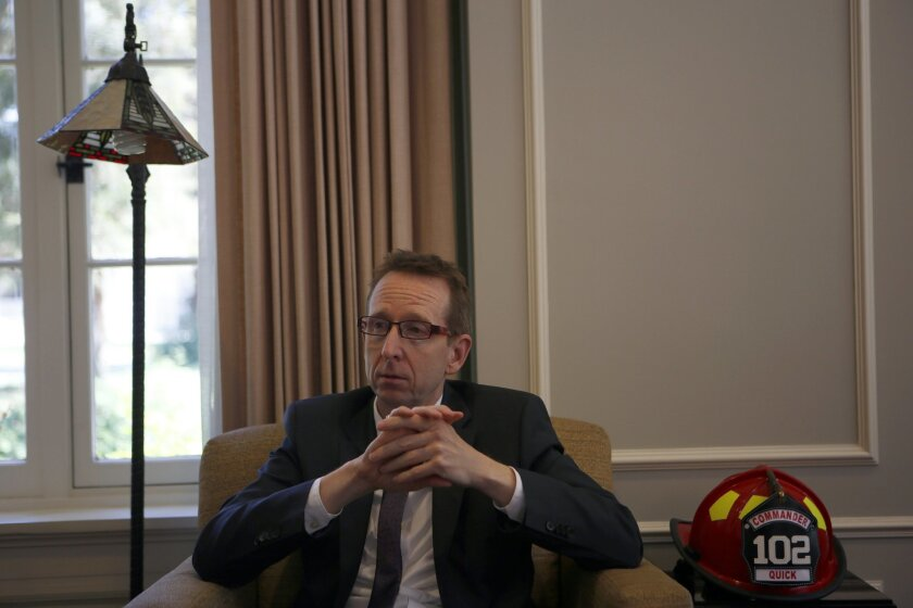 Michael Quick, the USC provost, in his office on July 16 discussing tensions with UC San Diego and his university's ambitions in the biomedical sciences. / photo by Francine Orr * Los Angeles Times