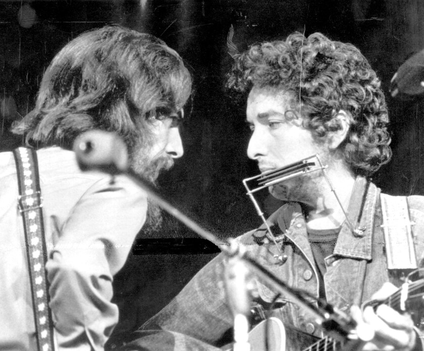 George Harrison, left, shown with Bob Dylan during the 1971 Concert For Bangladesh, will be the honoree of an all-star musical tribute on Sept. 28 at the Fonda Theatre in Hollywood.