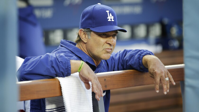 Dodgers Manager Don Mattingly looks on from the dugout during a game against the Philadelphia Phillies in April. Mattingly has grown frustrated with the team's ongoing struggles.
