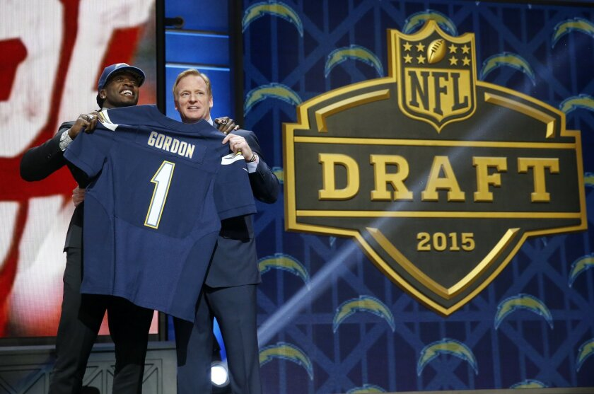 Wisconsin running back Melvin Gordon poses for photos with NFL commissioner Roger Goodell after being selected by the San Diego Chargers as the 15th pick in the first round of the 2015 NFL Draft,  Thursday, April 30, 2015, in Chicago. (AP Photo/Charles Rex Arbogast)