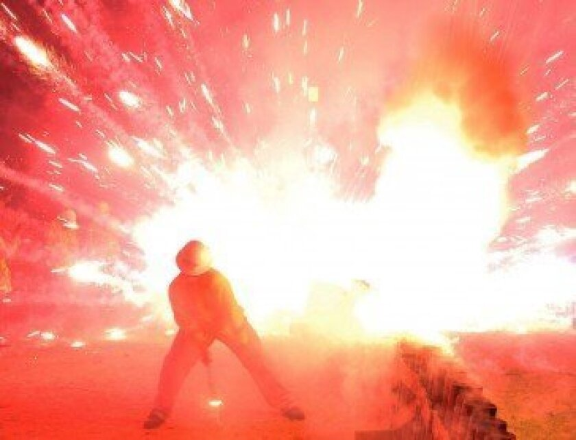 A photograph of a mortar that exploded on the ground during La Jolla's Fourth of July fireworks show. An environmental attorney who snuck into the secured area was escorted out less than a minute before the mishap, which representatives for Fireworks America say could have caused the attorn