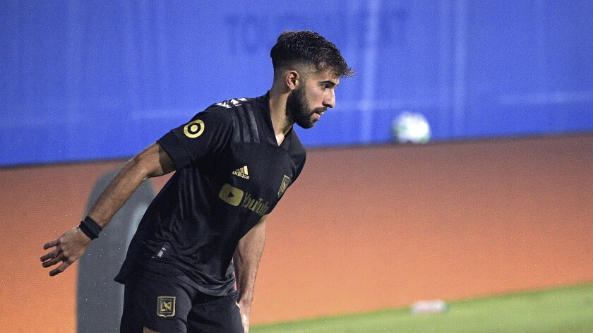 LAFC forward Diego Rossi sets up a play during a match.