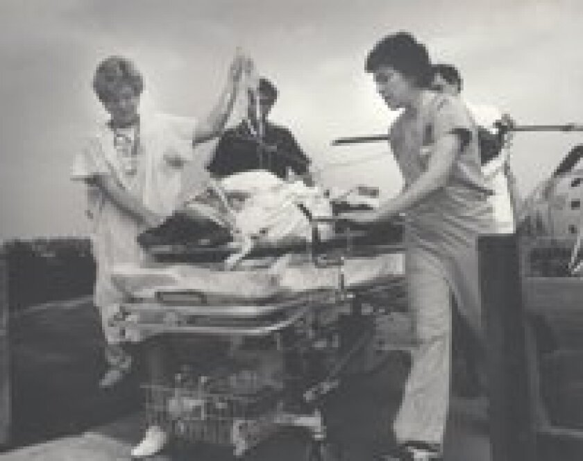 A patient is transported by stretcher after being transported to the hospital by helicopter in the 1970s.  Photos courtesy of Sarita Eastman