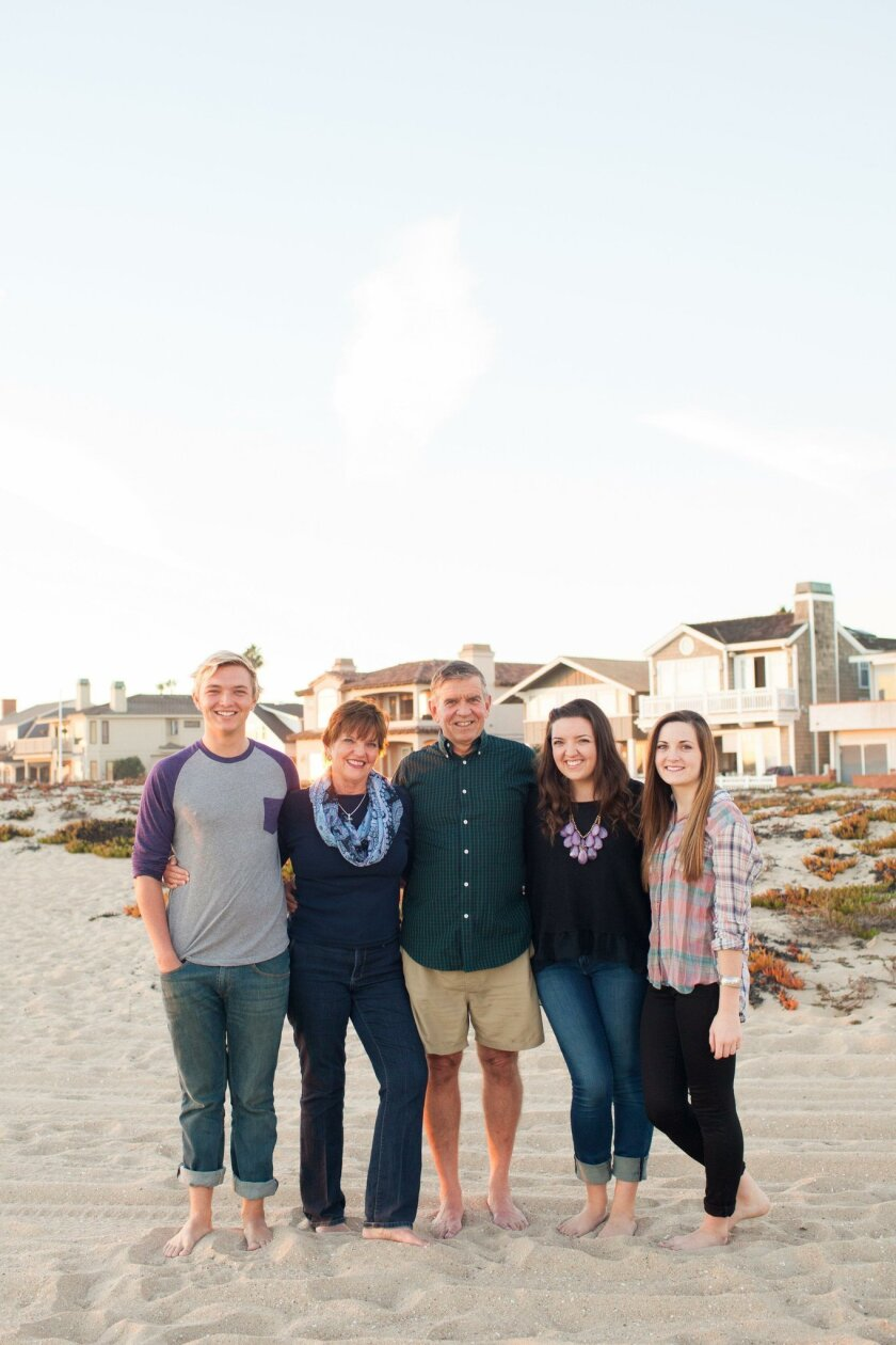 Doug Perkins with wife Carolyn and their three children, on the beach in Del Mar.