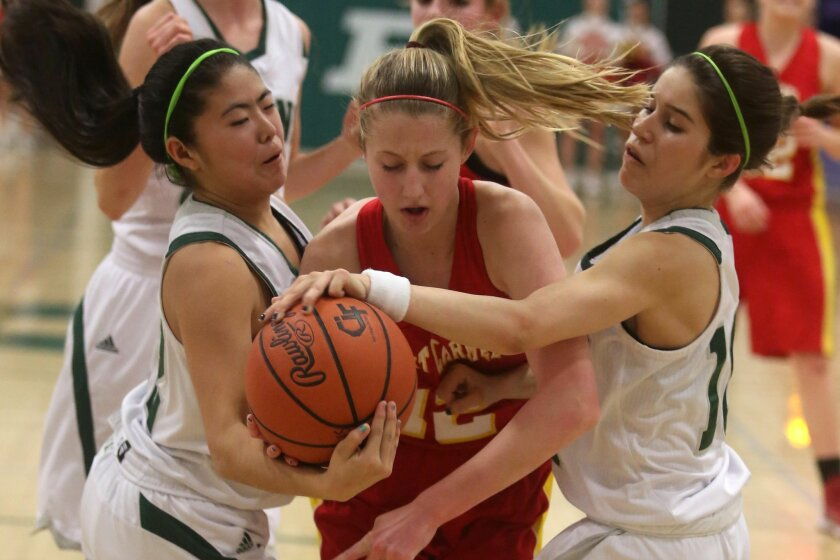 Poway's Daryn Ikeda (left, white jersey, in a photo from last season) shows some of the trademark defense that earned her all-tournament honors.