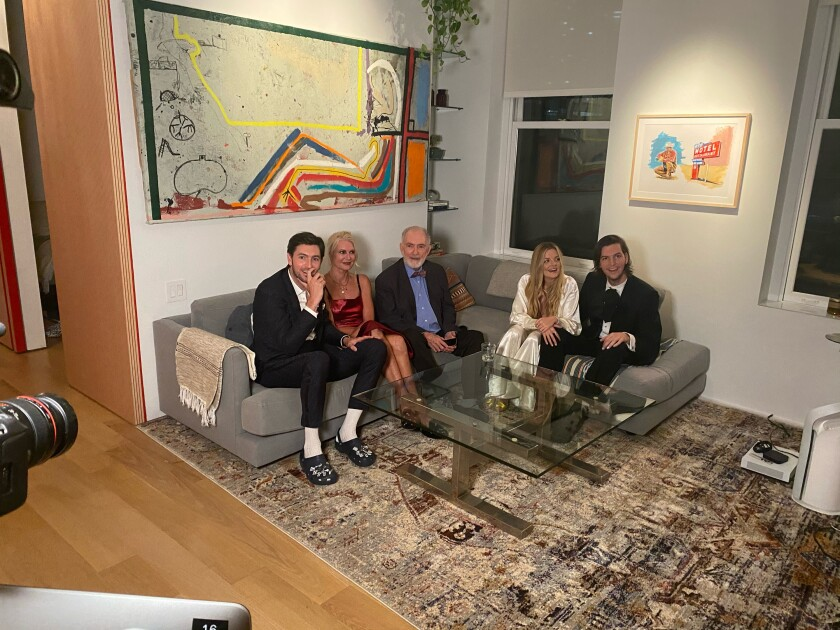 """Nicholas Braun from the show """"Succession"""" with his mom, dad, brother and brother's girlfriend, watch the Emmys."""