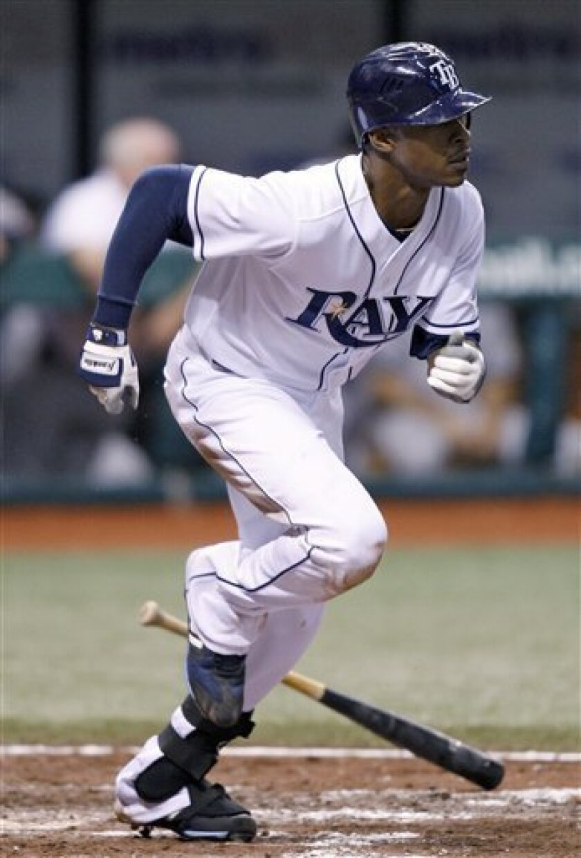 Tampa Bay Rays' B.J. Upton heads to first base after hitting a fifth-inning single off New York Yankees pitcher David Robertson during a baseball game Friday, Oct. 2, 2009 in St. Petersburg, Fla. Upton becomes the first player in team history to hit for the cycle. (AP Photo/Chris O'Meara)