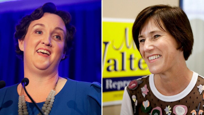 Left, Democratic congressional candidate Katie Porter speaks during an election night event in Tusti