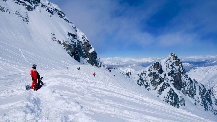 Trekking the ridge before the drop into a wide-open bowl at Blackcomb Glacier.