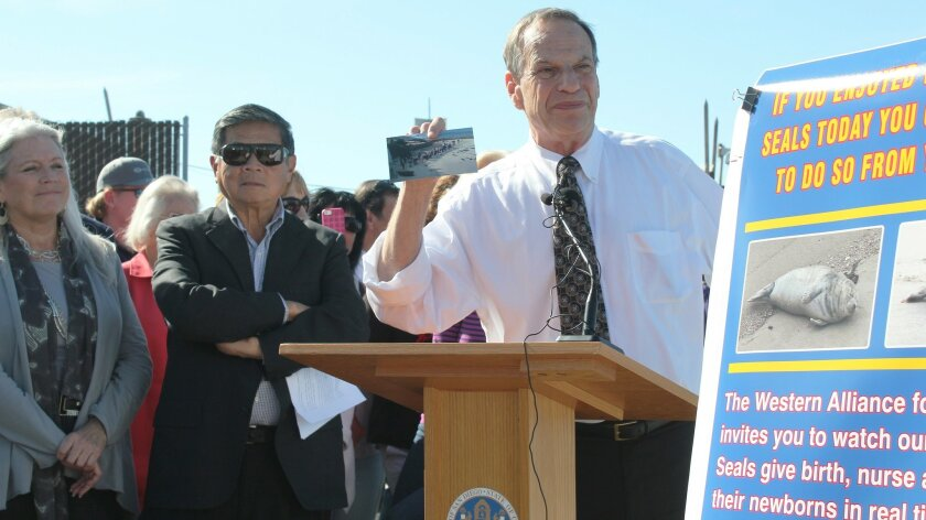 San Diego Mayor Bob Filner held a press conference at Children's Pool beach earlier this year. At left is his former communications director, Irene McCormack Jackson, who has retained Los Angeles attorney Glorial Allred to represent her in a sexual harassment suit against the mayor and the city. File
