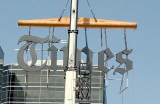 Los Angeles Times sign goes up on new building