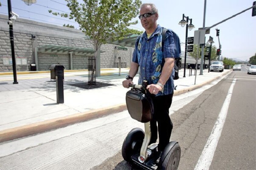SDSU professor Jesse Dixon rode his scooter in a bike lane during 