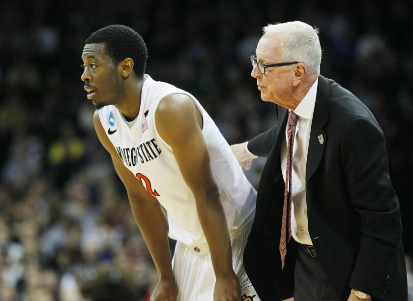 SDSU's Xavier Thames  and Steve Fisher talks during a time out against North Dakota State.