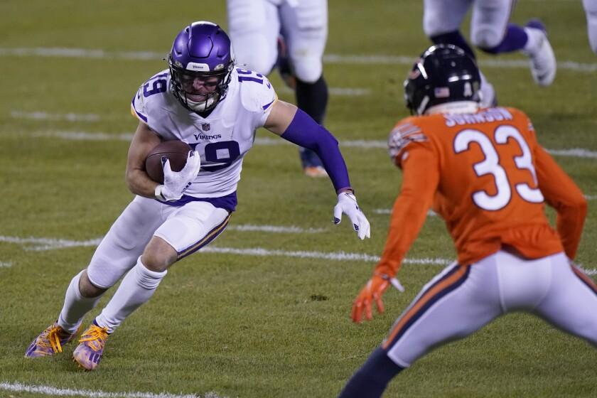 Minnesota Vikings wide receiver Adam Thielen tries to get past Chicago Bears cornerback Jaylon Johnson on Nov. 16.