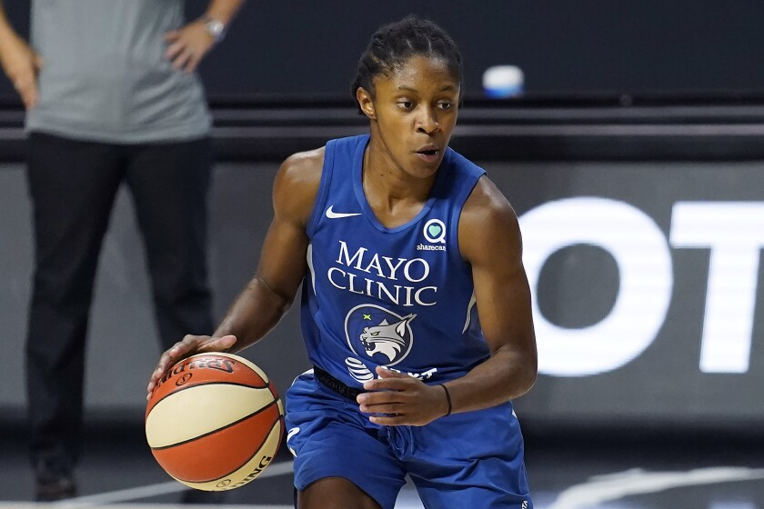 Minnesota Lynx guard Crystal Dangerfield (2) drives up the fllor against the Phoenix Mercury during the second half of a WNBA playoff basketball game Thursday, Sept. 17, 2020, in Bradenton, Fla. (AP Photo/Chris O'Meara)