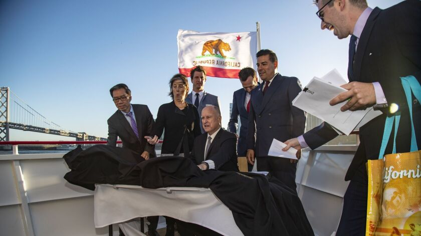 SAN FRANCISCO, CA - SEPTEMBER 13, 2018: The wind kicks up as Gov. Jerry Brown prepares to sign many