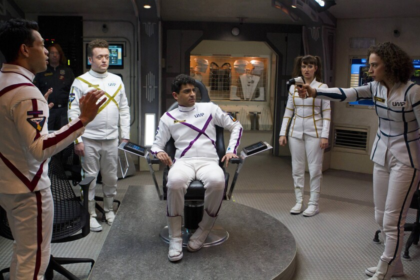 """Eugene Cordero, from left, Joel Hodgson, Neil Casey, Karan Soni, Milana Vayntrub and Bess Rous have a tense moment in Paul Feig's sci-fi comedy """"Other Space,"""" now on Yahoo Screen."""