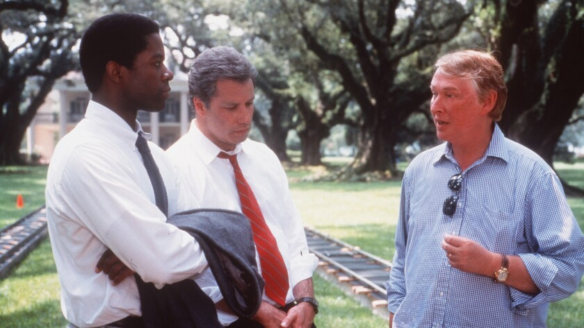 """Mike Nichols, right, directs Adrian Lester, left, and John Travolta in the 1998 film """"Primary Colors."""""""