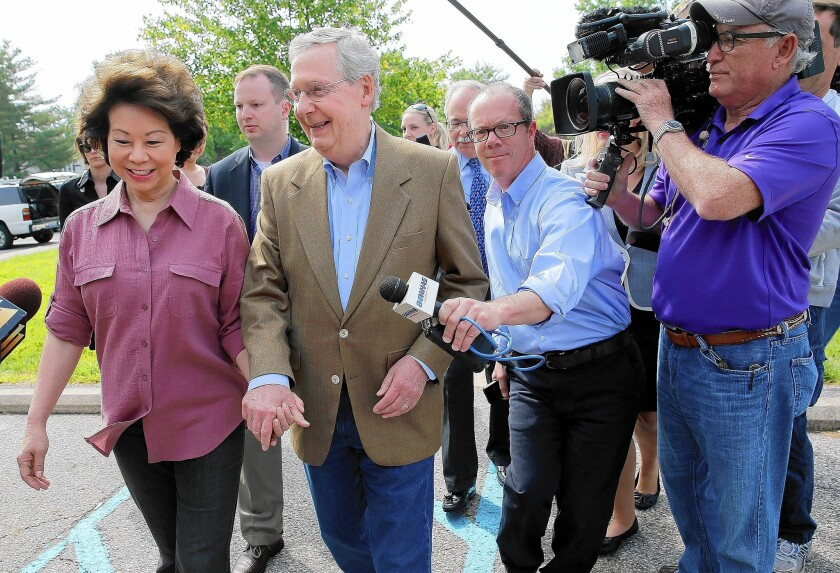 Sen. Mitch McConnell and his wife, Elaine Chao, after voting in Kentucky's Republican primary, in which McConnell defeated tea party favorite Matt Bevin.