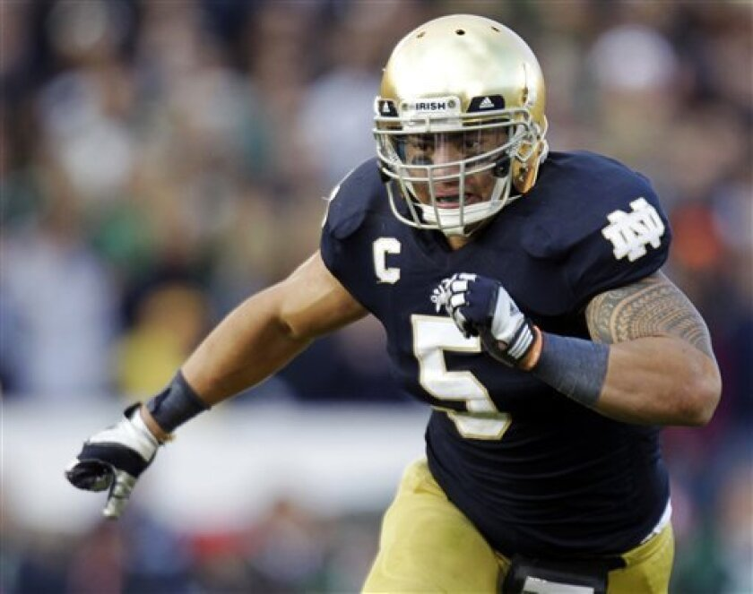 FILE - In this Oct. 20, 2012, file photo, Notre Dame linebacker Manti Te'o chases the action during the second half of an NCAA college football game against BYU in South Bend, Ind. The wrenching story of Te'o's girlfriend dying of leukemia _ a loss he said inspired him to play his best all the way