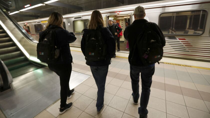 From left, Jennie Mauries, Karen Barnes and Andrew Tisbert with the homeless assistance group PATH embark on January's homeless count at a Red Line station.